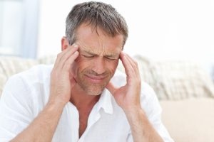 tmj symptoms - man holding temples